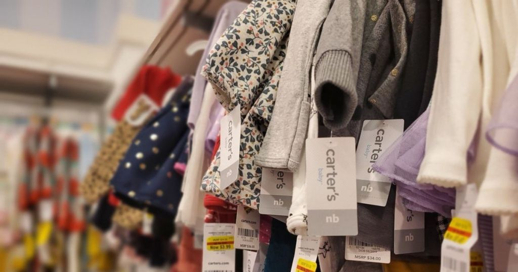Carter's baby apparel hanging in store with clearance tags