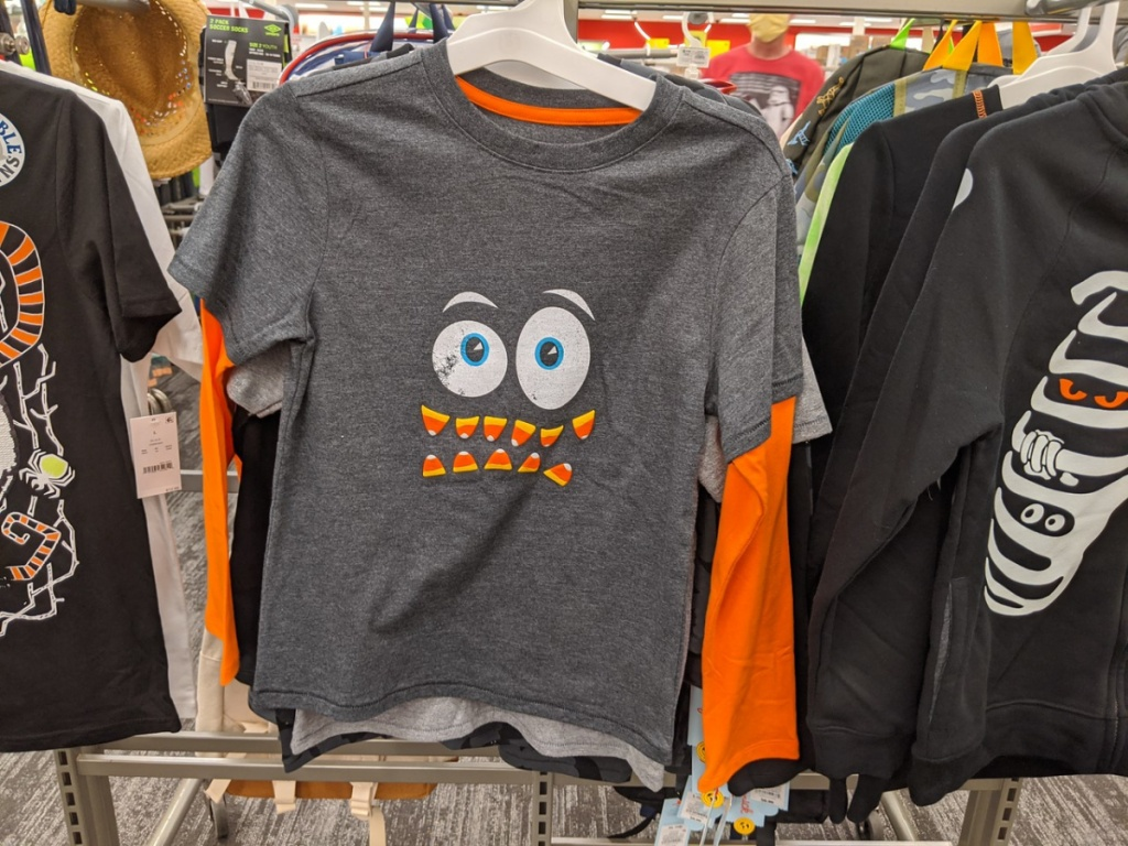 store display with Halloween shirts hanging