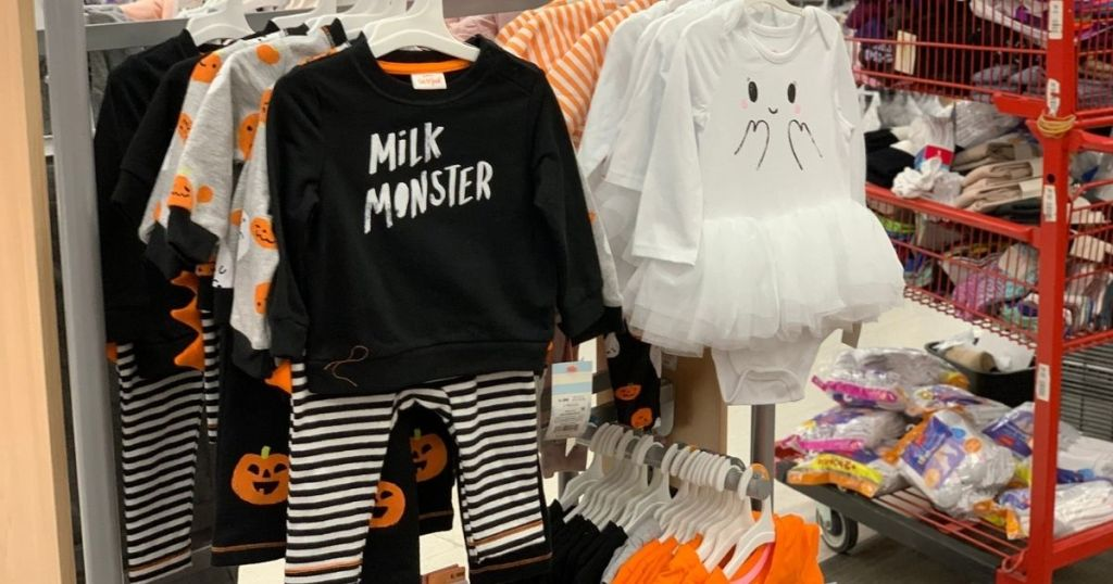 Milk Monster and ghost tutu outfits hanging up in store