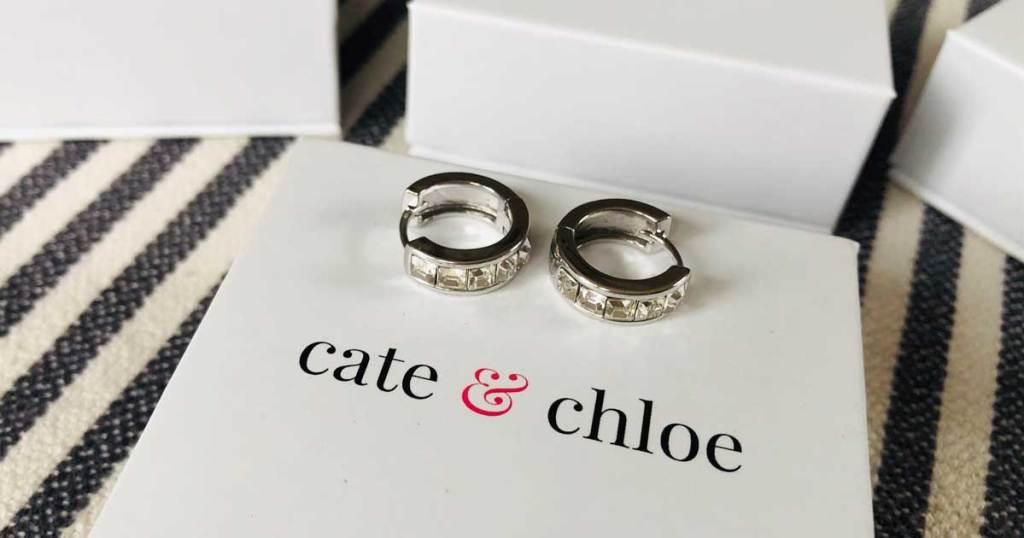 hoop earrings with diamonds displayed on a jewelry box