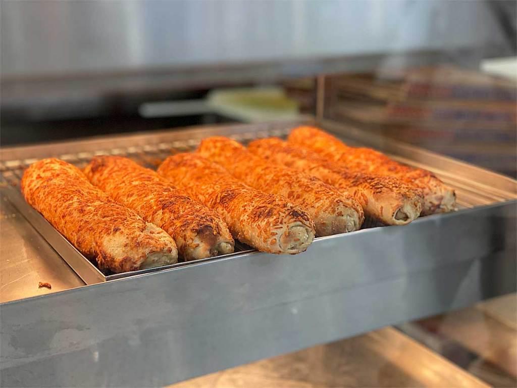 Chicken bake loafs in row in a warmer in-store