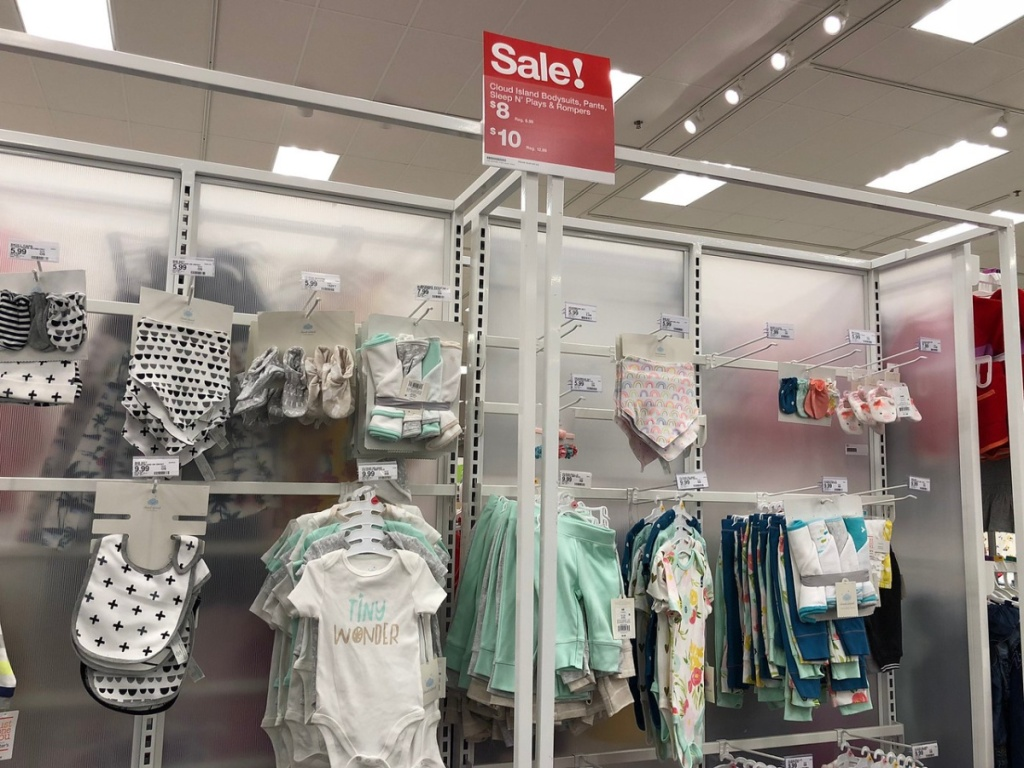 store with baby clothes hanging up for display