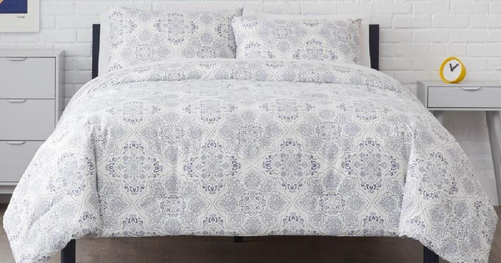 gray comforter set on bed