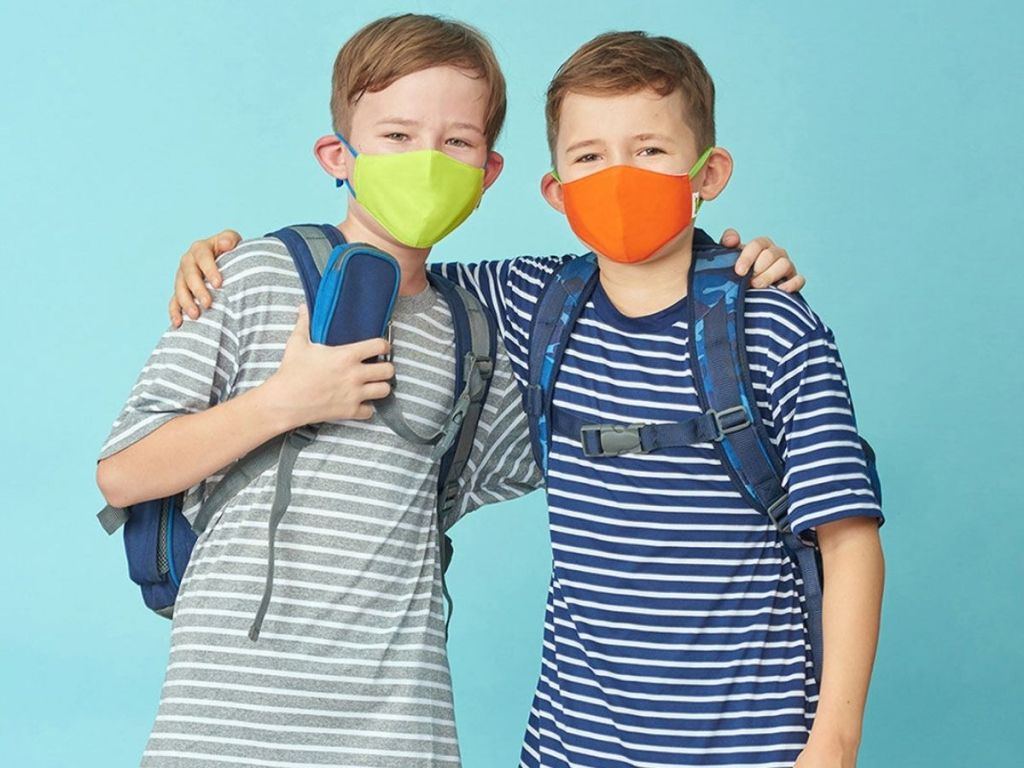 boys wearing green and orange face masks and striped shirts