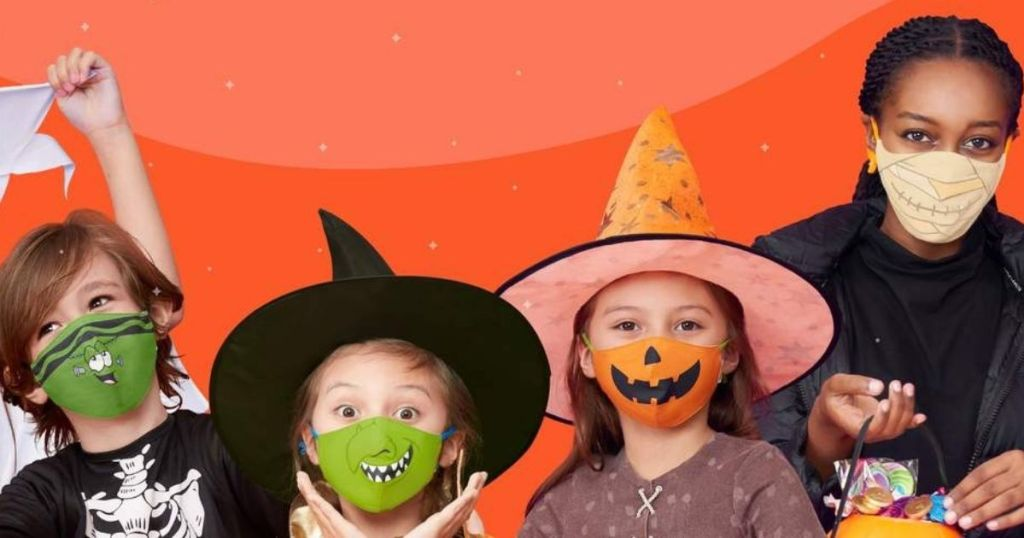 kids wearing Halloween themed face masks with orange backdrop