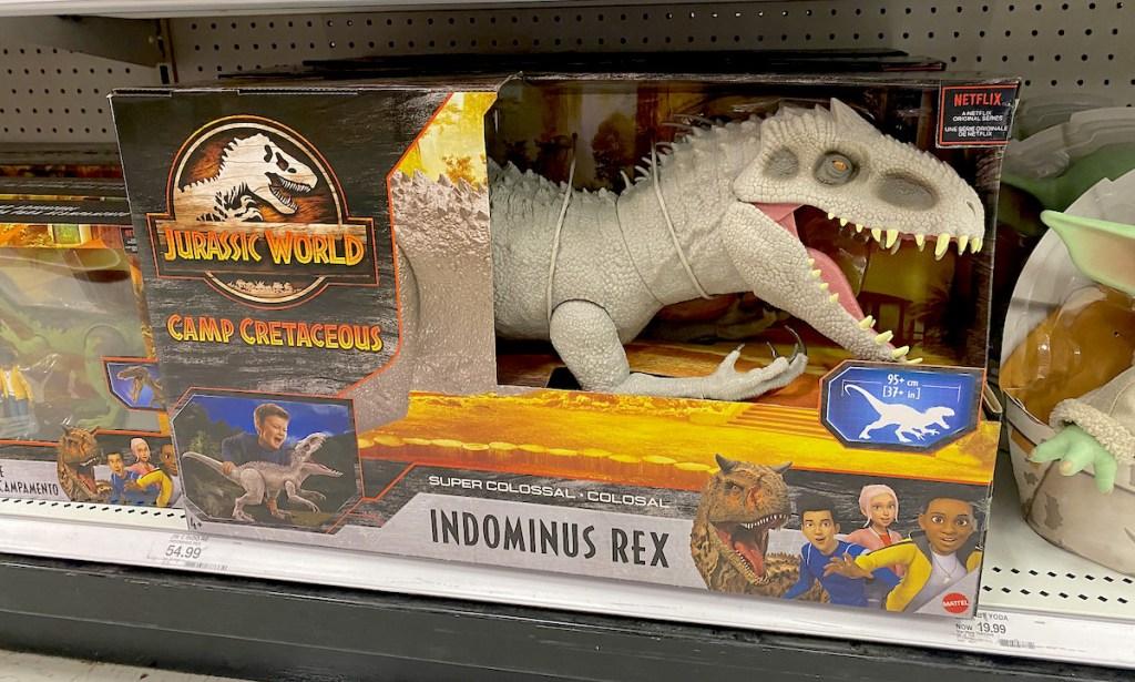 jurassic world dinosaur sitting on Target hottest toys shelf