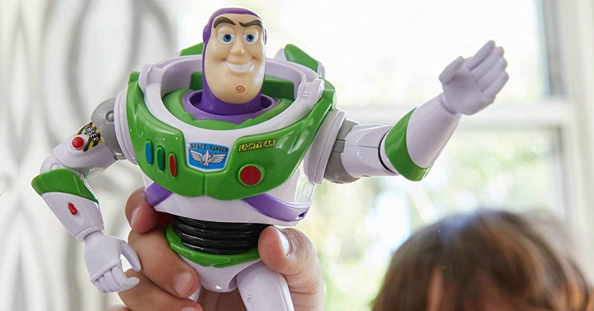 child playing with a buzz lightyear toy