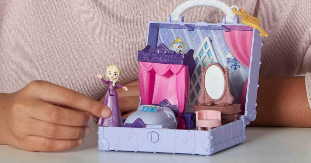 girl playing with disney pop up adventure house