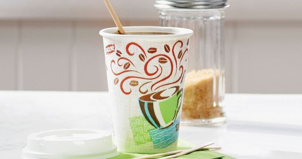 dixie insulated cup with coffee in it and stir stick in it