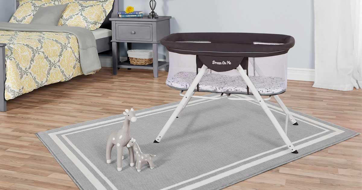 baby bassinet set up in bedroom