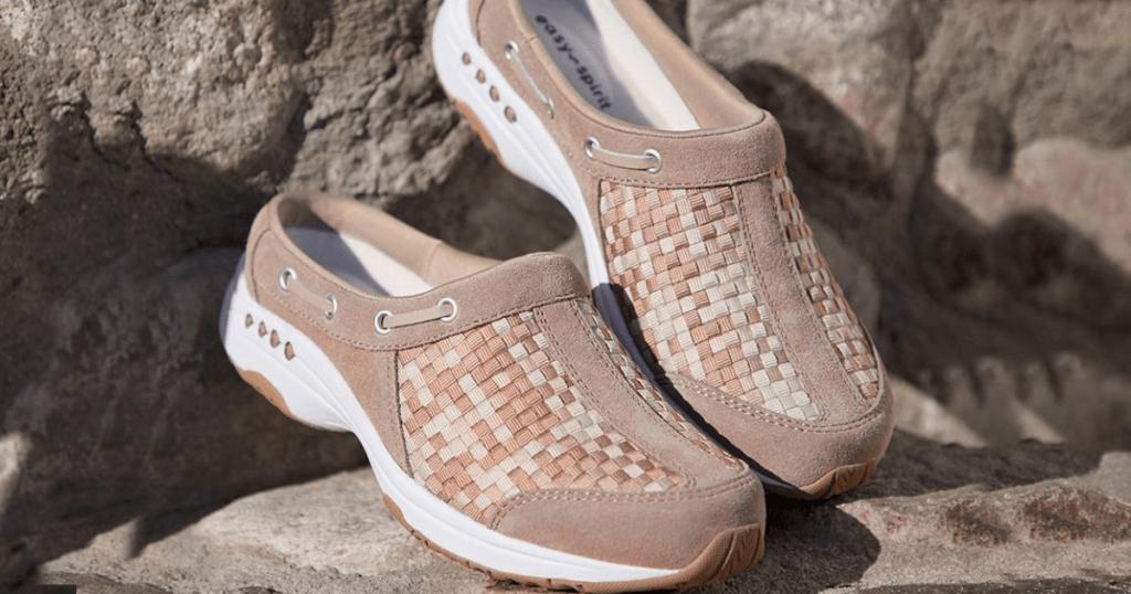shoes sitting on rocks outside
