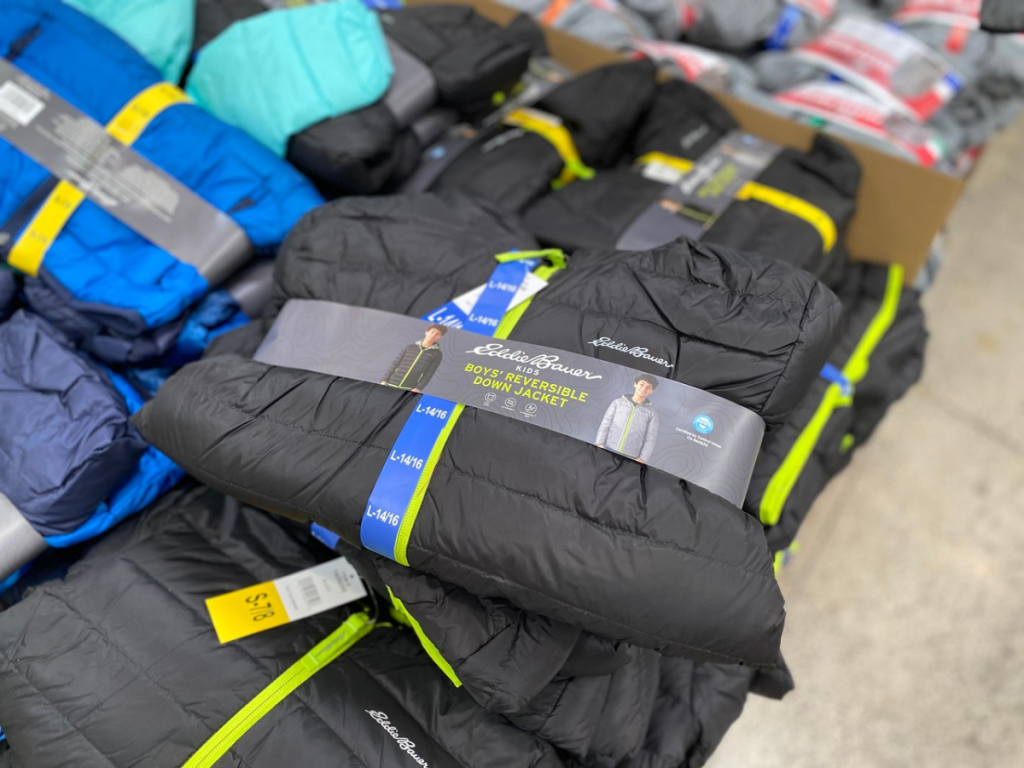 stack of kids winter jackets in a store