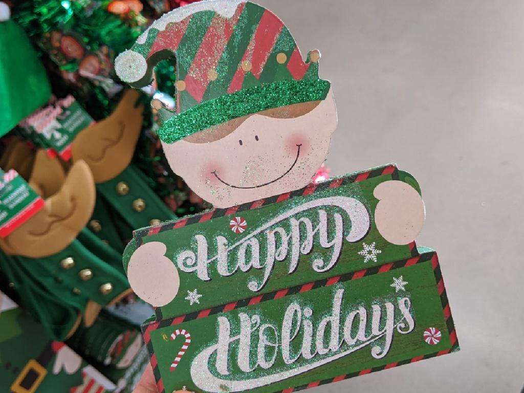 wooden sign shaped like an Elf with Christmas greetings
