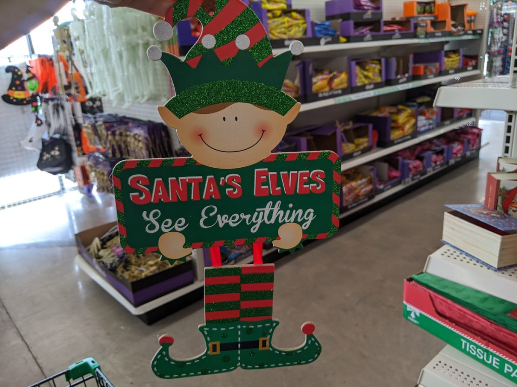 Wooden elf sign being shown in a store