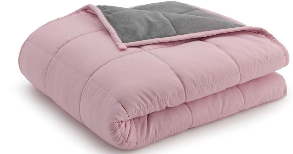 pink and gray reversible weighted blanket folded up