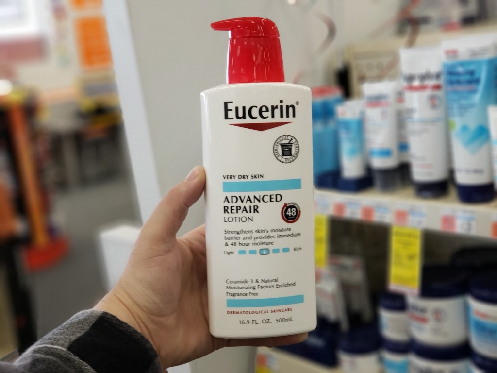 eucerin advanced repair lotion bottle in hand