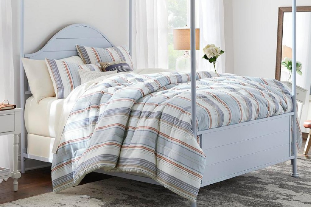 farmhouse striped bedding set on rot iron bed