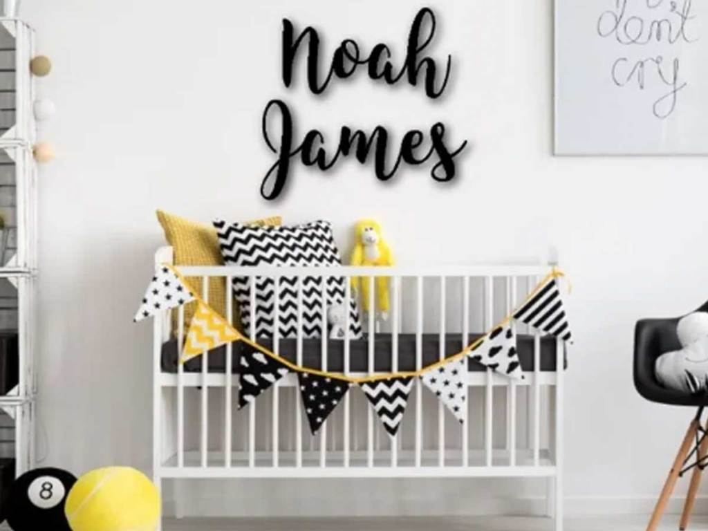 the name noah james on a wall in a baby room