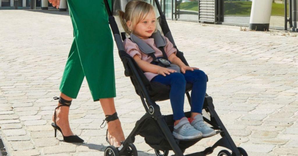 girl riding in a stroller