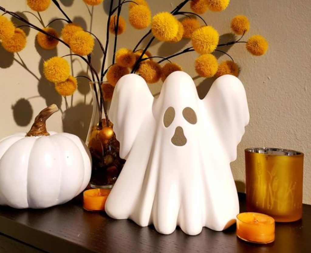 white ghost on table with other halloween yankee candle decor