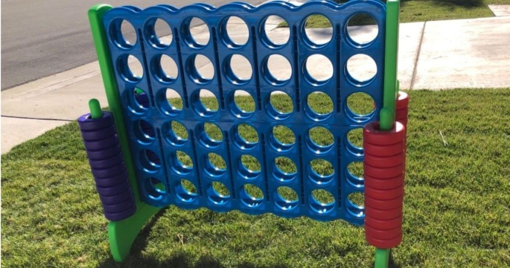 giant blue connect 4 game outdoors