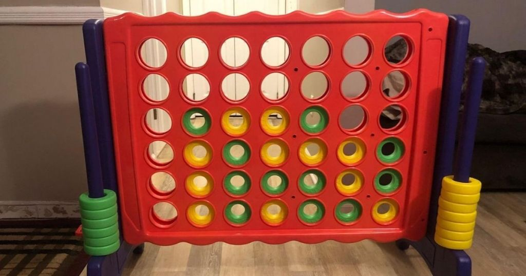 giant red connect 4 game indoors