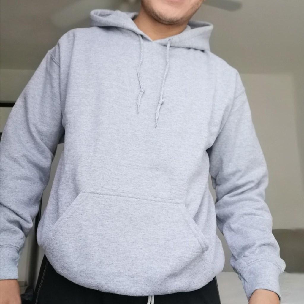man wearing gray hooded sweatshirt
