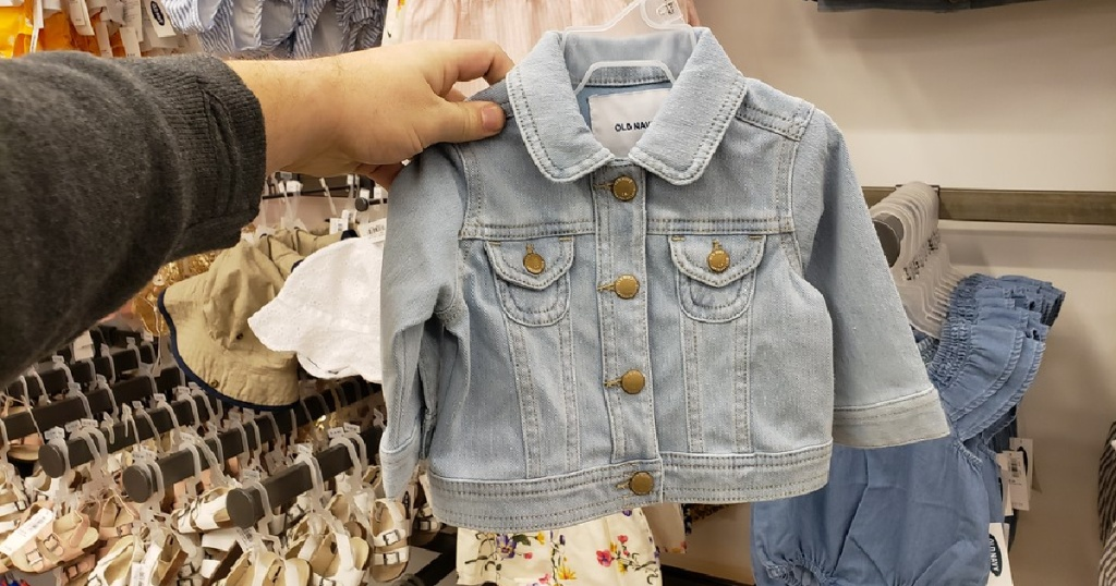 hand holding toddler girls old navy jean jacket
