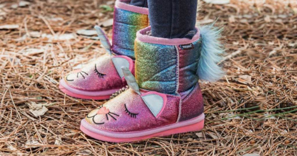 little girl wearing glitter boots cat