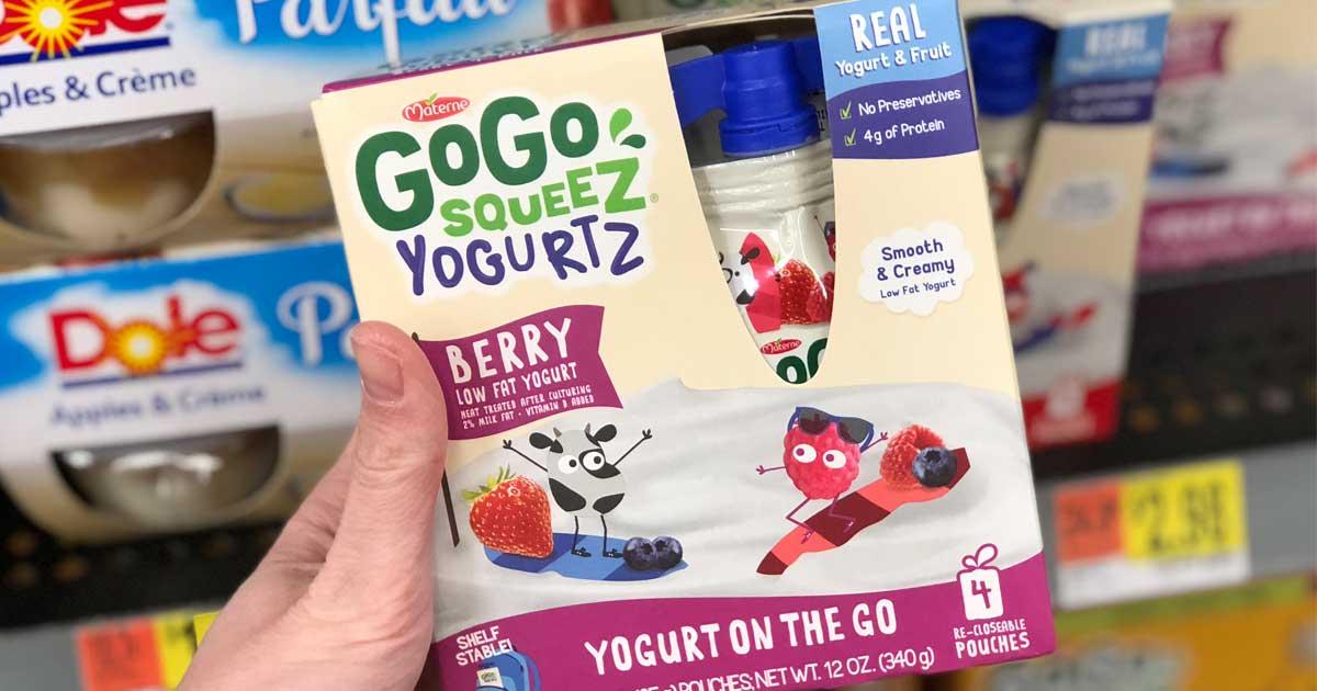 hand holding box of yogurt snack