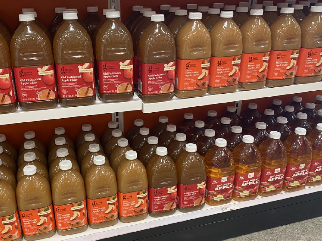 bottles of juice on store shelf