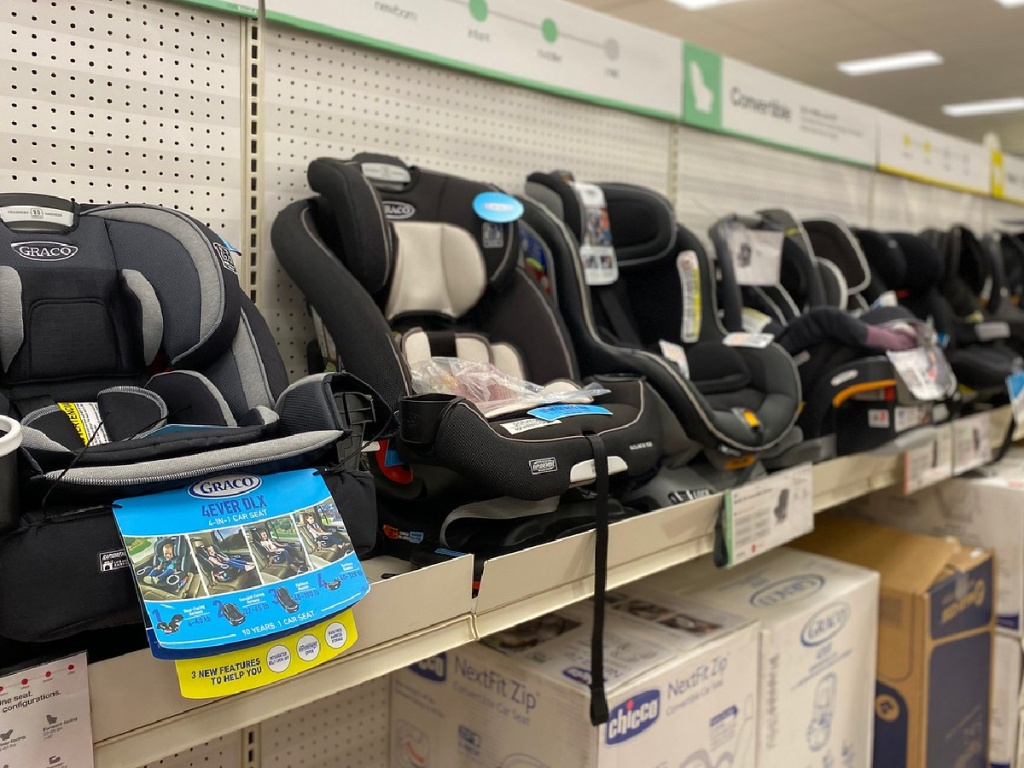 rows of car seats on display in store