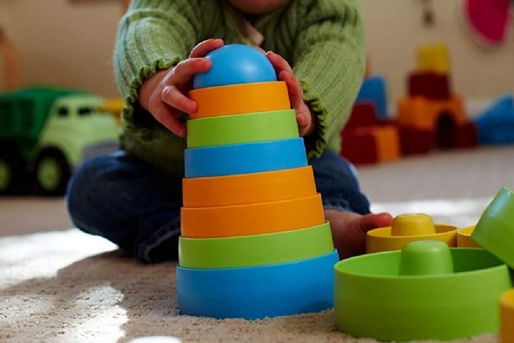 little boy stacking toys