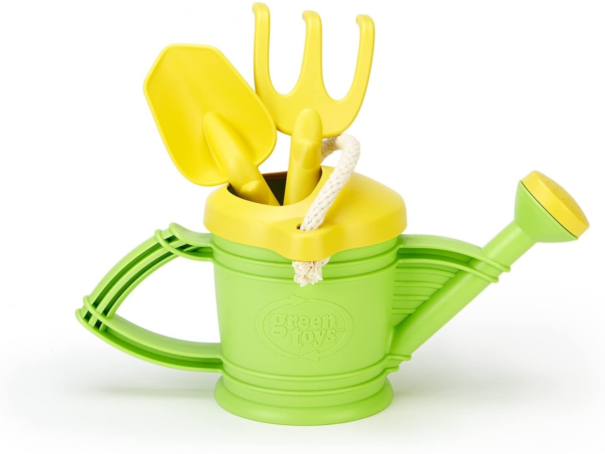 Green water can with small hand rake and shovel put in the top