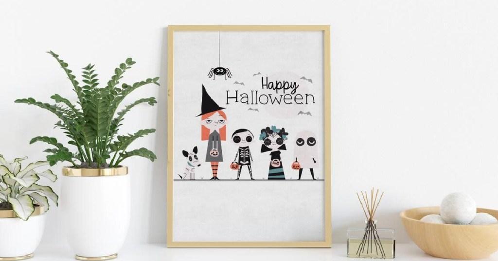 halloween kids print hung on white wall