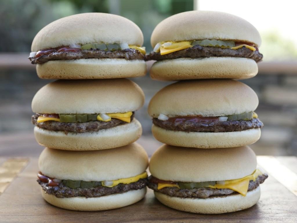 2 piles of 3 cheeseburgers