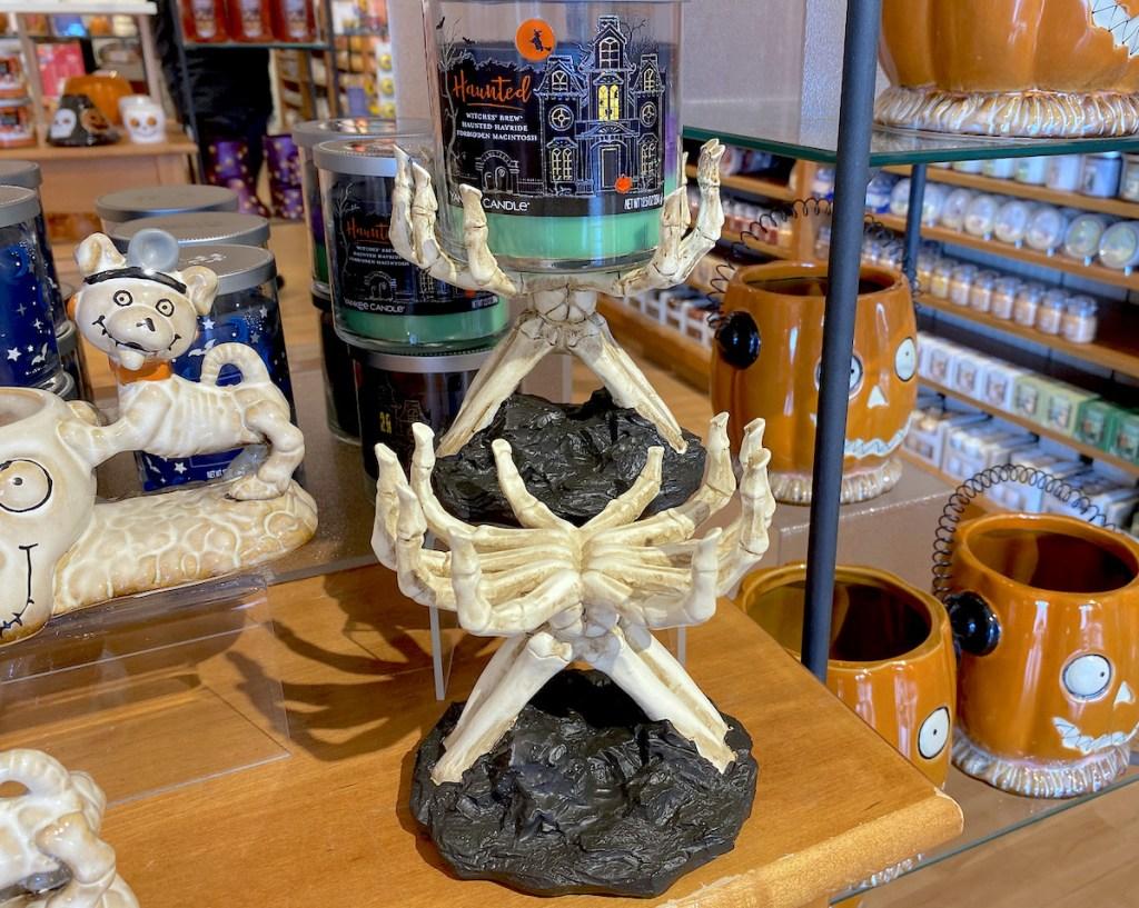 skeleton hands candle holders on store shelf