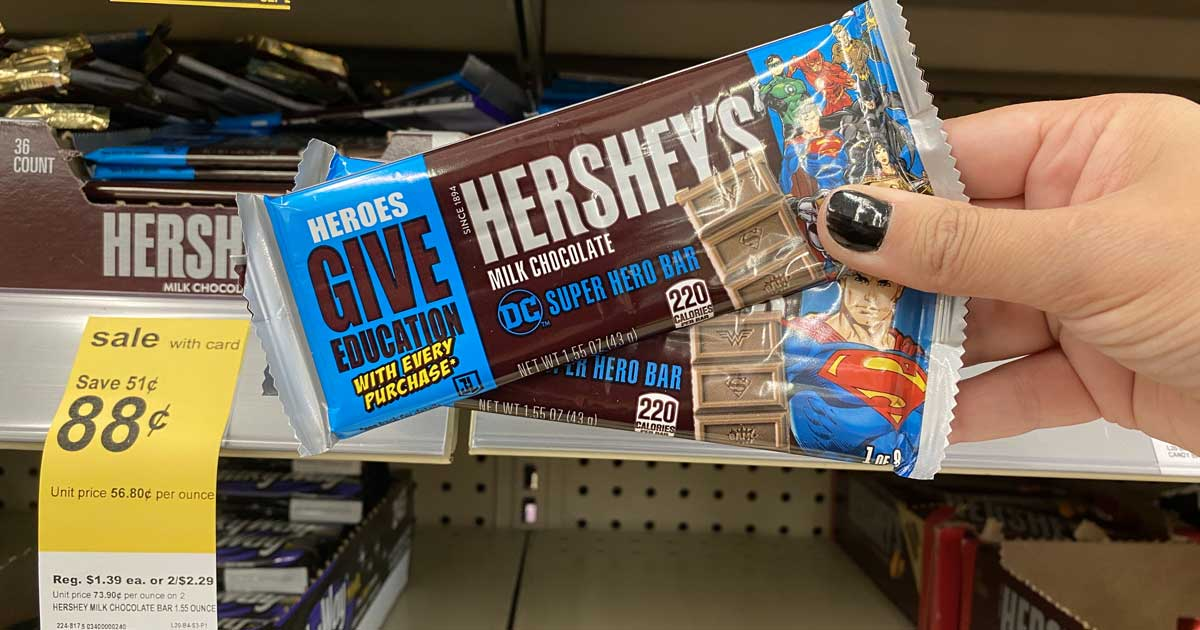 hersheys candy bar being held up with a hand