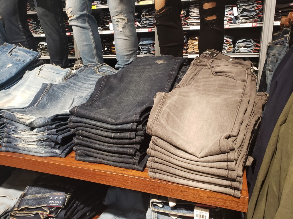 hollister guys jeans folded on shelf