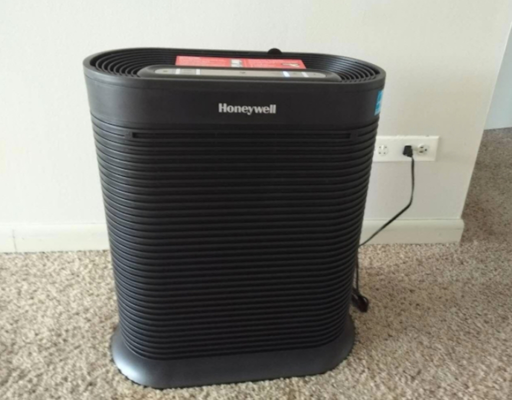 black honeywell air purifier sitting on carpet floor