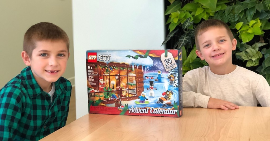 boys sitting at wood table with lego city advent calendar