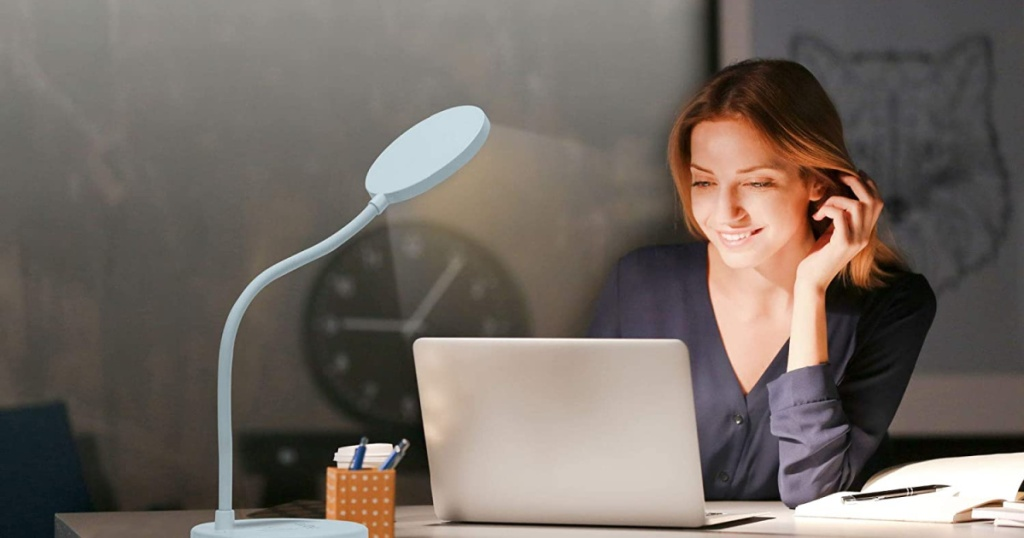ihome LED lamp with woman sitting at desk