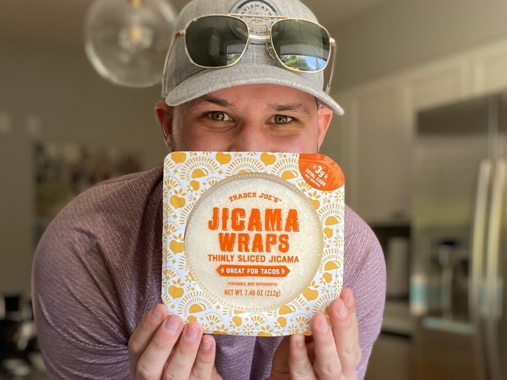 man holding package of jicama wraps
