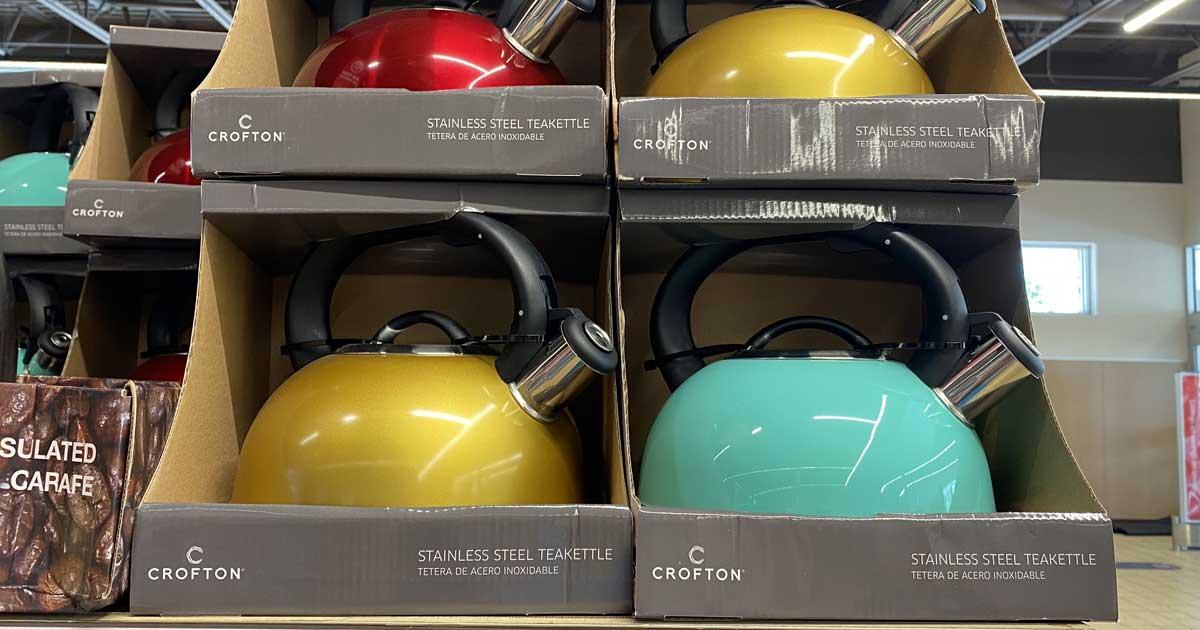 shelf display of tea kettles in bright colors