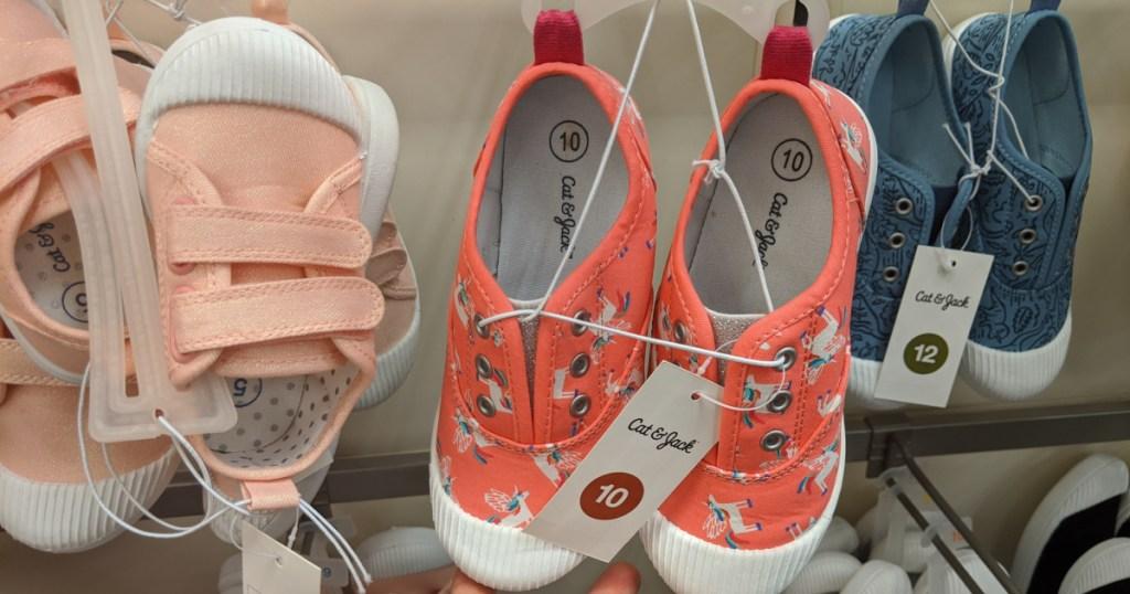 kids sneakers at target in hand