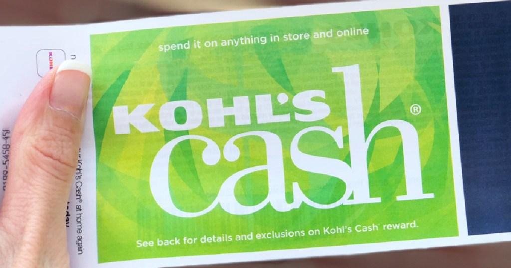 hand gripping Kohl's Cash