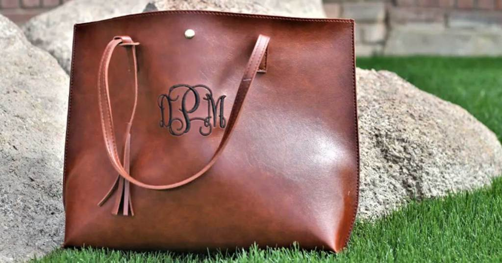 brown leather like tote bag on grass