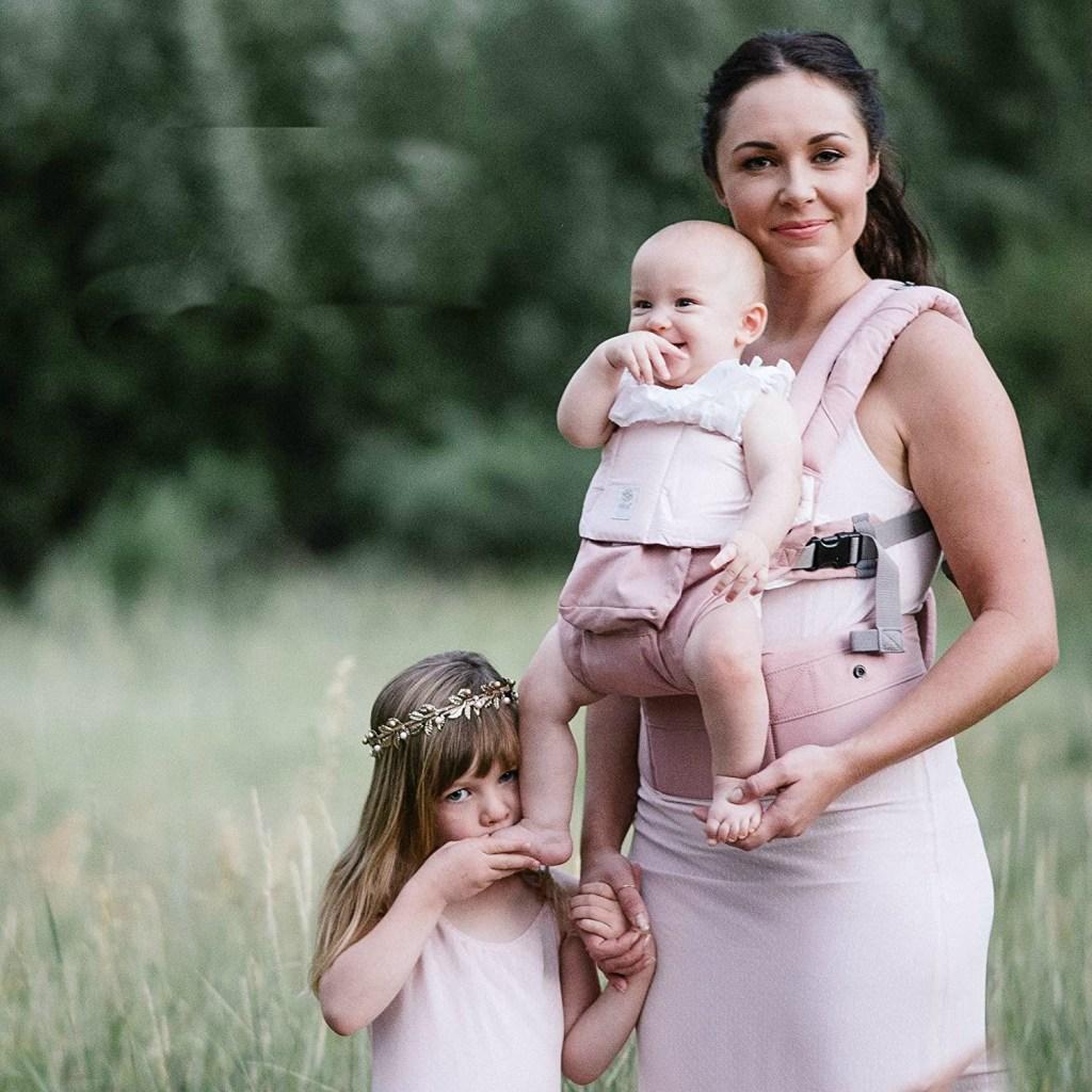 woman wearing lillebaby blushing pink carrier
