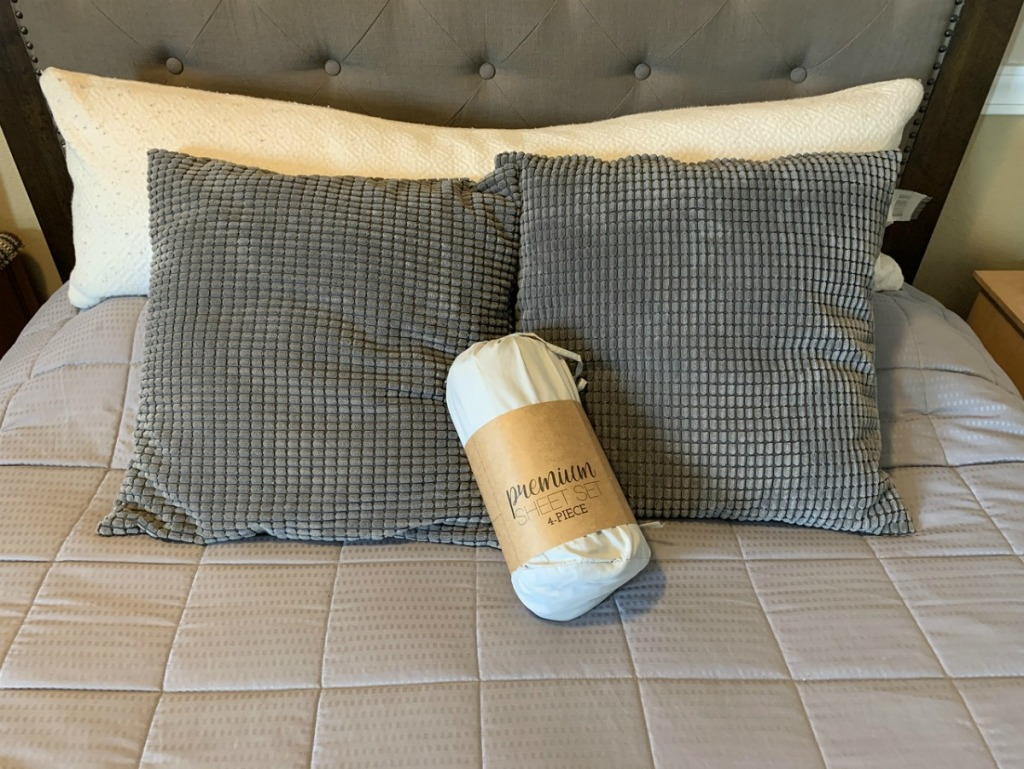 linens & hutch sheet set on bed
