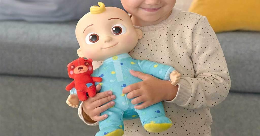 little girl holding a doll